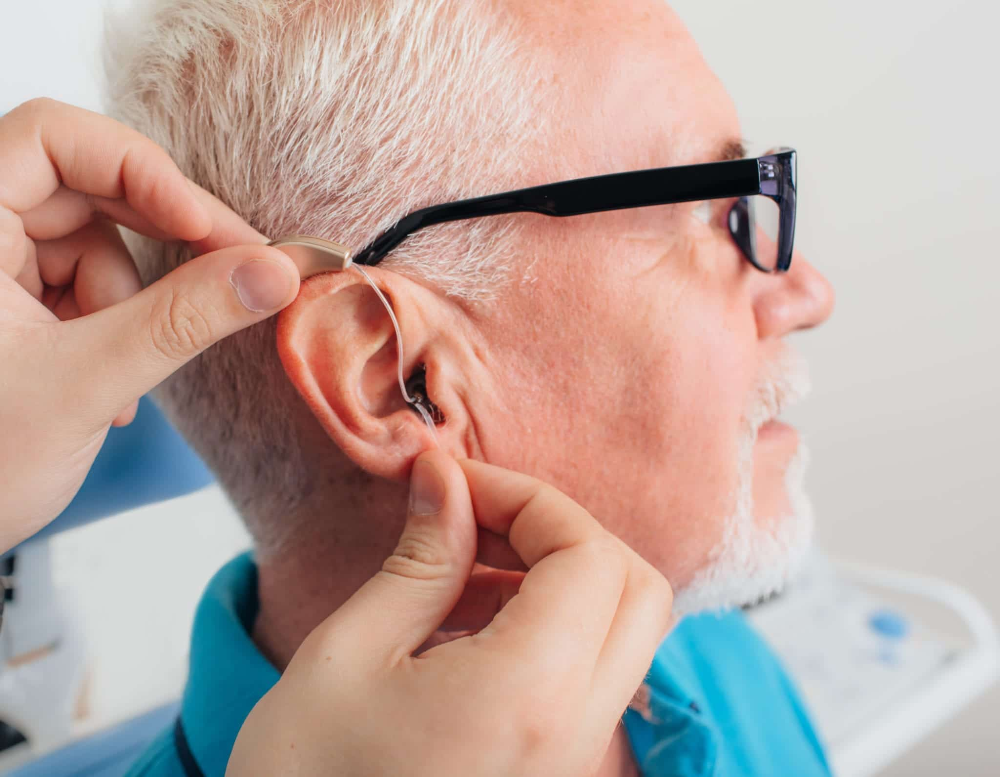 adjusting of a hearing aid for an aged man