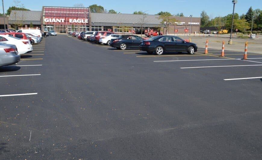 A filled parking lot after resurfacing was completed.