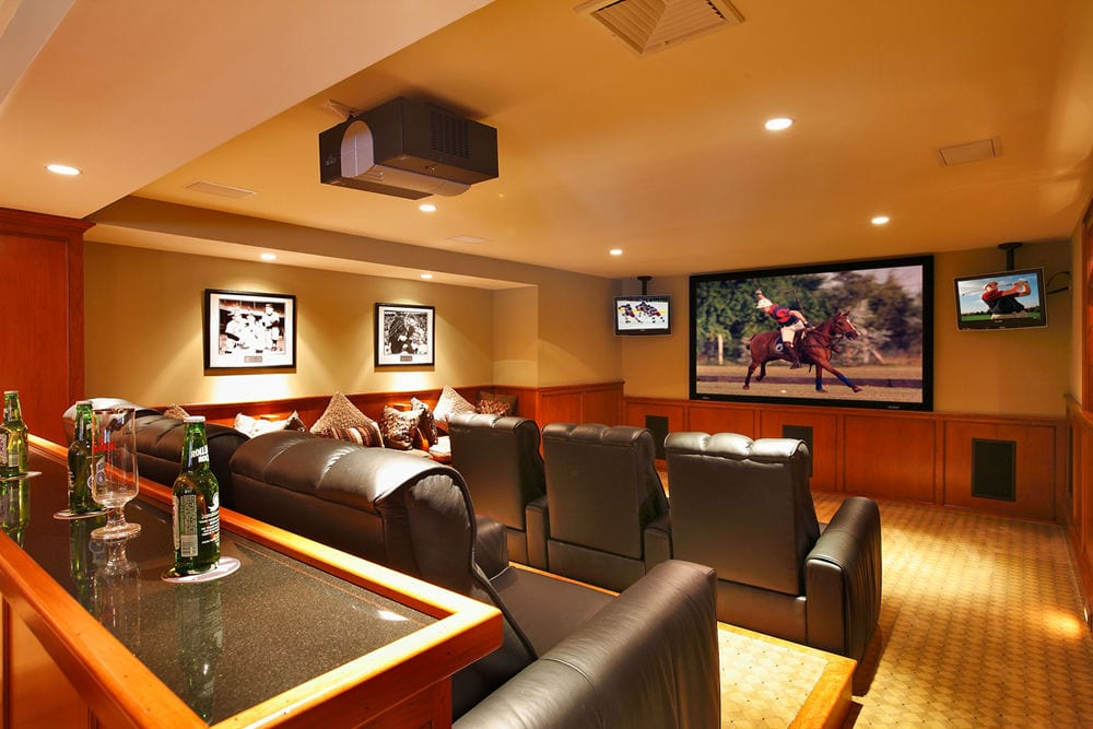 home theater room with a bar, billiards, and gaming tables