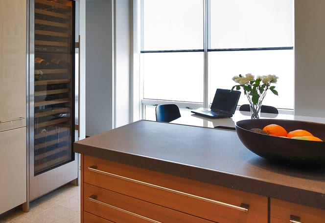 modern kitchen with a laptop on the table